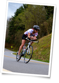 Triathlete Michelle takes a corner on the scenic Welcome Ride near Brevard, North Carolina