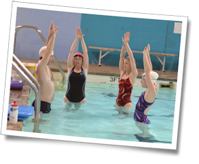 Triathletes practice streamline at the pool.